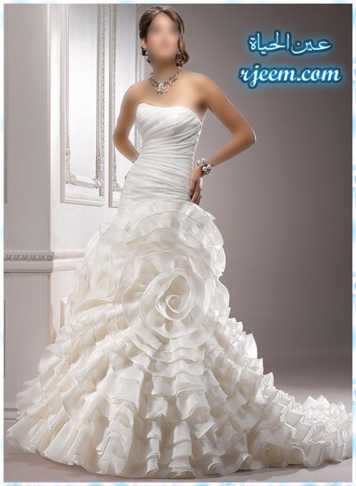 بفستانك فرحك(معرض 13697360643.jpg