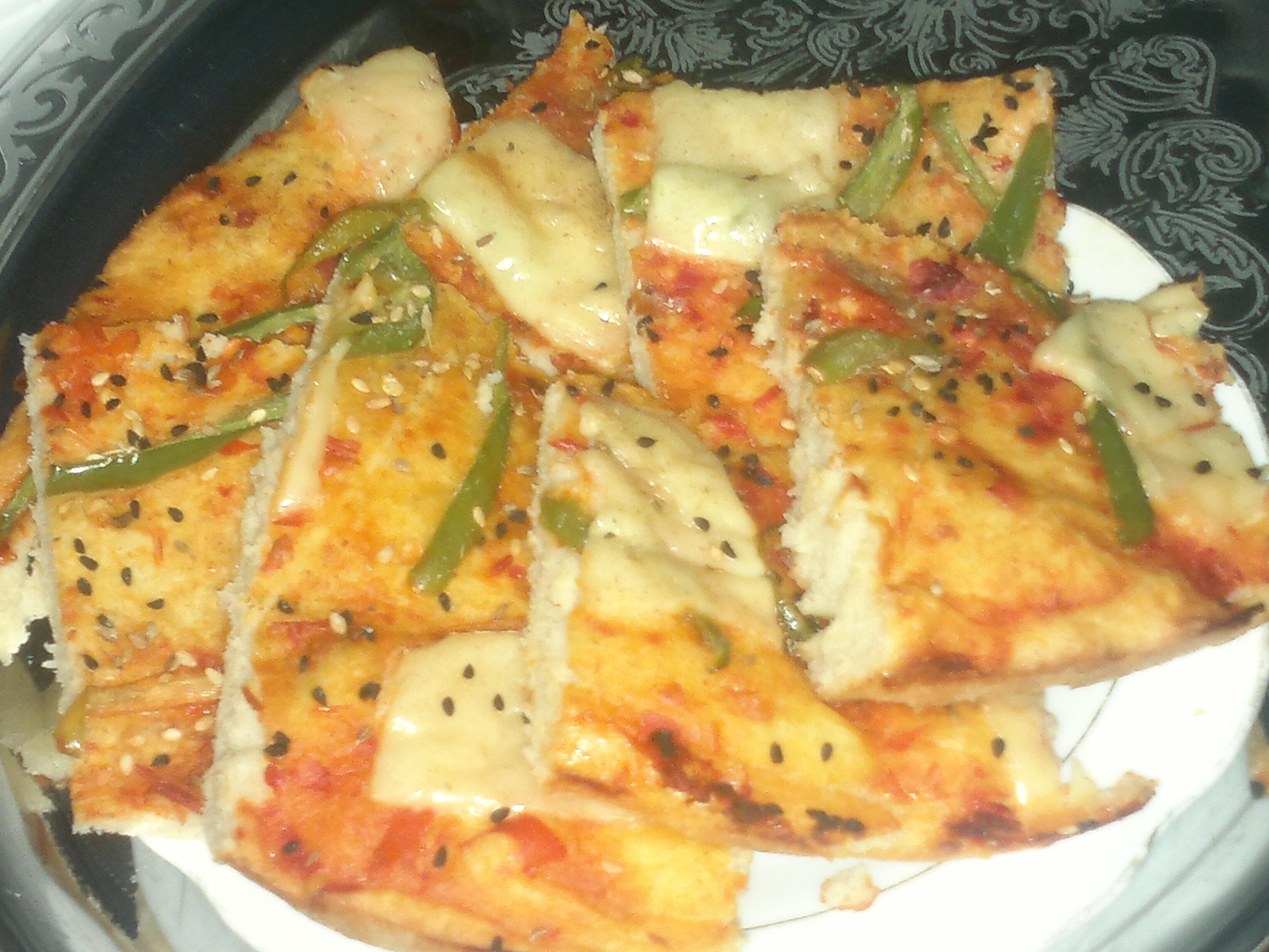 البيتزا بـأعشاب التخسيس 13887060953.jpg
