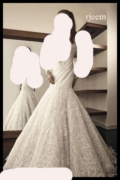 فساتين زفاف رائعة وانيقة للمصمم رامي سلمون 2014 13983766671.jpg